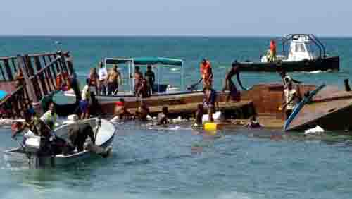 Rescue boats and people search for survivors after Djibouti-flagged vessel sank off coast of Djibouti